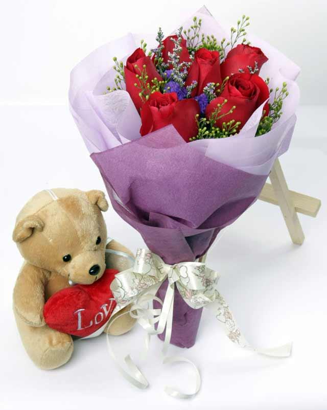 oyuncak ve 7 adet kirmizi gül buketi  Ankara Anadolu online çiçekçi , çiçek siparişi